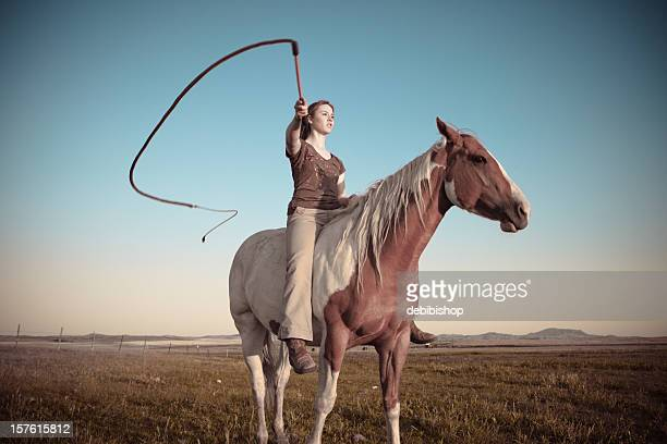 young woman on horseback - women with whips stock pictures, royalty-free photos & images