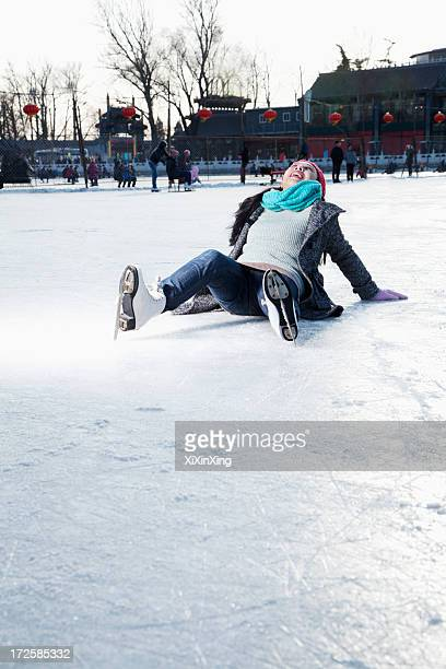 Young woman on ice rink