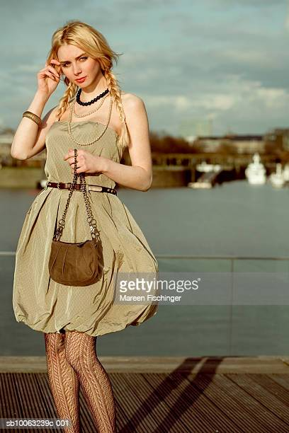 Young woman on jetty, portrait