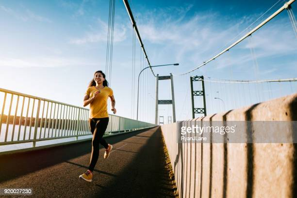 Young Woman on Morning Run in Urban Setting