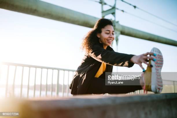 Young Woman on Morning Run in Urban Setting