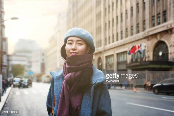 a young woman on nanjing road in shanghai,china - east asia, - nanjing road stock pictures, royalty-free photos & images