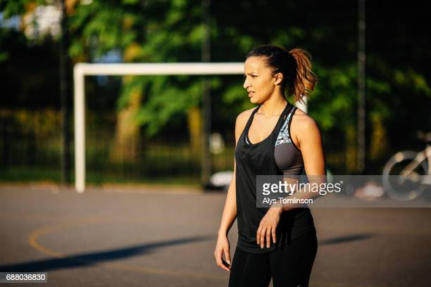young woman on outdoor sports court in park