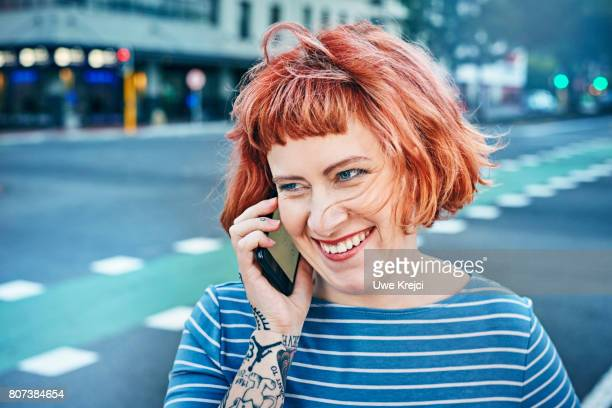 young woman on phone - female body piercing stock photos and pictures