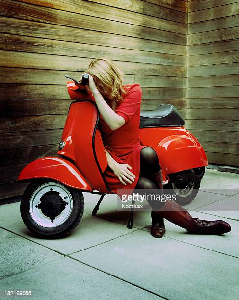 young woman on red vintage retro scooter - stocking tops stock photos and pictures