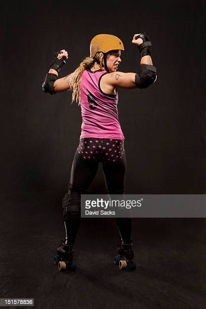 Young woman on roller skates flexing
