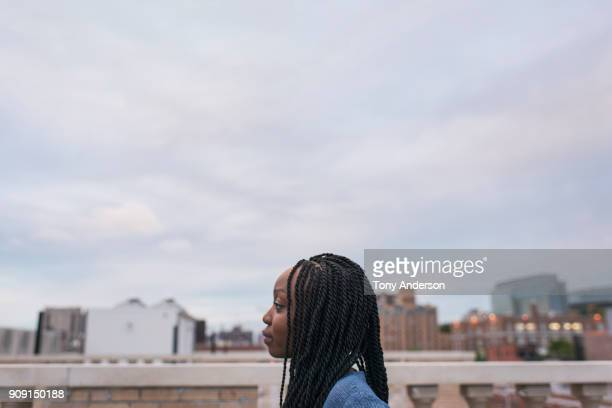 Young woman on rooftop in city