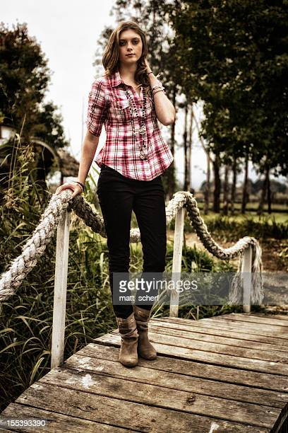 Young Woman On Rope Bridge