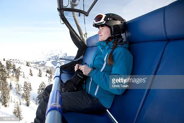 Young woman on ski lift