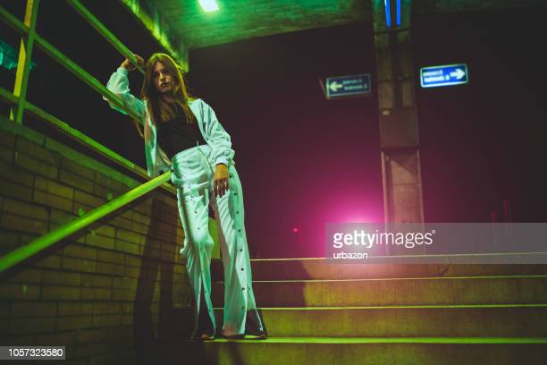 young woman on stairs - letter a stock pictures, royalty-free photos & images