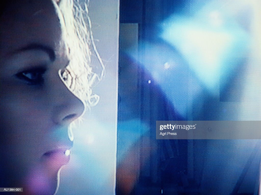 Young woman on studio set, profile, backlit (video still) : Stock Photo
