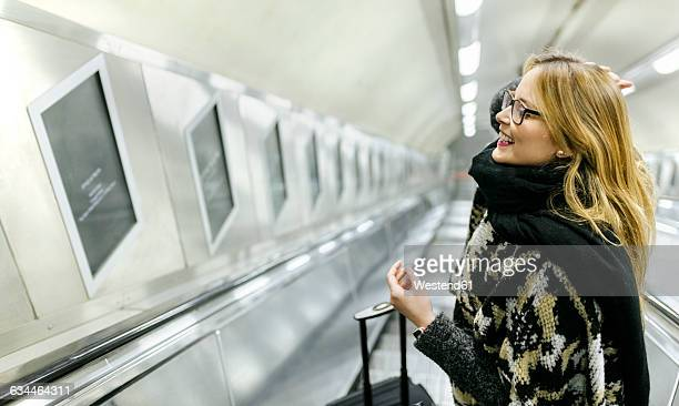 Young woman on subway escalators