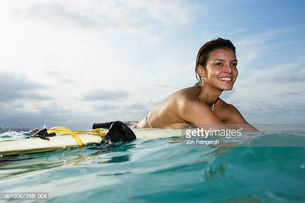 Young woman on surfboard