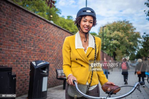 young woman on the go - cycling helmet stock photos and pictures
