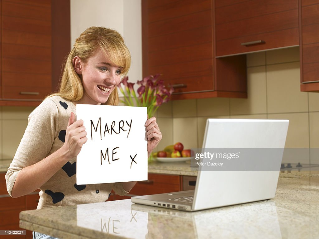 Young woman on the internet with marry me sign : Stock Photo