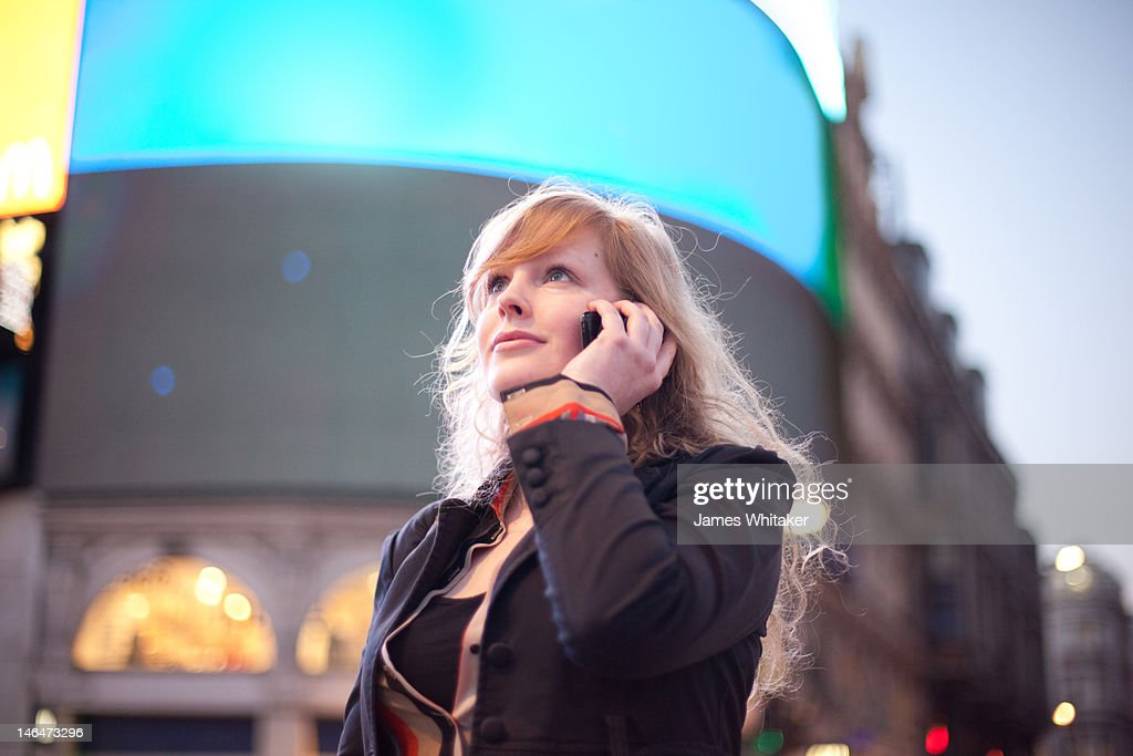 Young Woman on the Phone in the centre of the City : ストックフォト