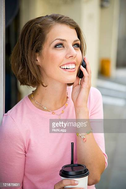young woman on the phone - rich_legg stock pictures, royalty-free photos & images