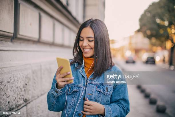 young woman on the street - denim jacket stock pictures, royalty-free photos & images