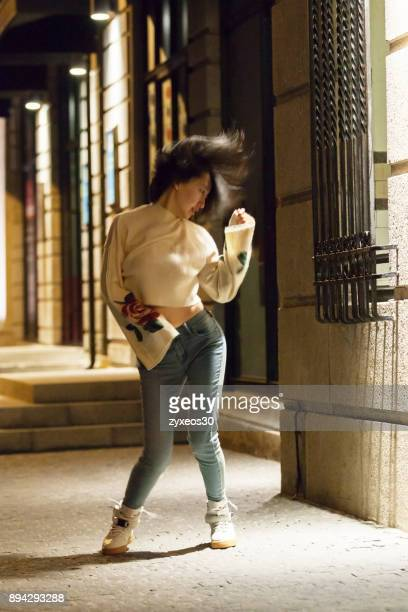 A young woman on the streets dance of Shanghai's bund,China - East Asia,