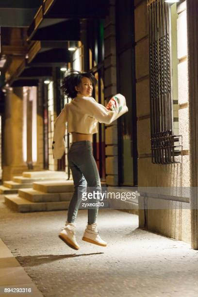 a young woman on the streets dance of shanghai's bund,china - east asia, - china east asia stock pictures, royalty-free photos & images