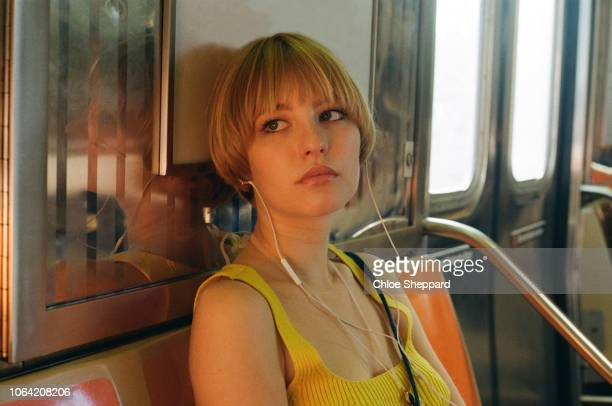 young woman on the subway in nyc - underground stock pictures, royalty-free photos & images