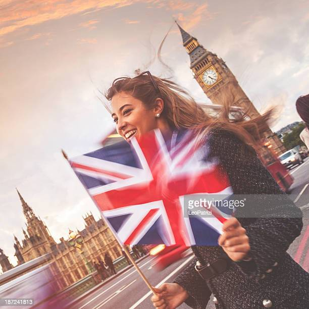 young woman on the westminster bridge - union jack stock photos and pictures