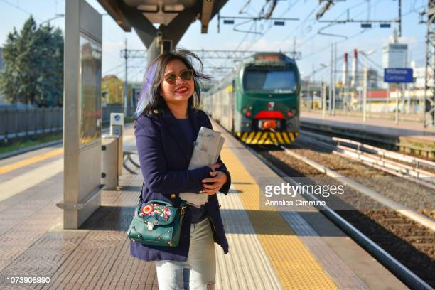 young woman on train platform - millennial pink stock pictures, royalty-free photos & images