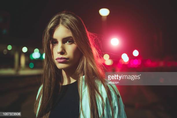 young woman on train station - girls stock pictures, royalty-free photos & images
