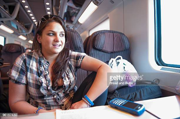 young woman on train trip - train interior stock photos and pictures