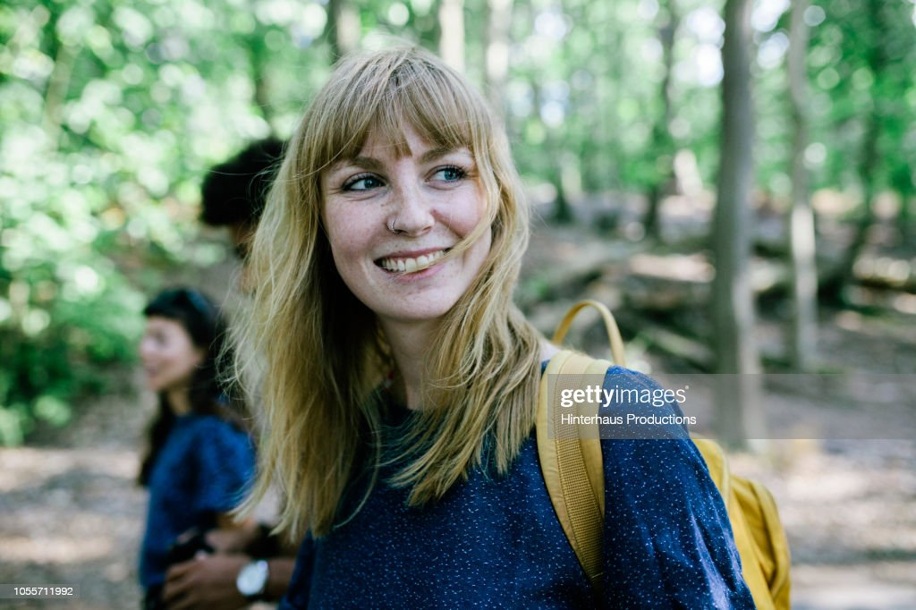 Young Woman On Way To Lake With Friends : Stock Photo