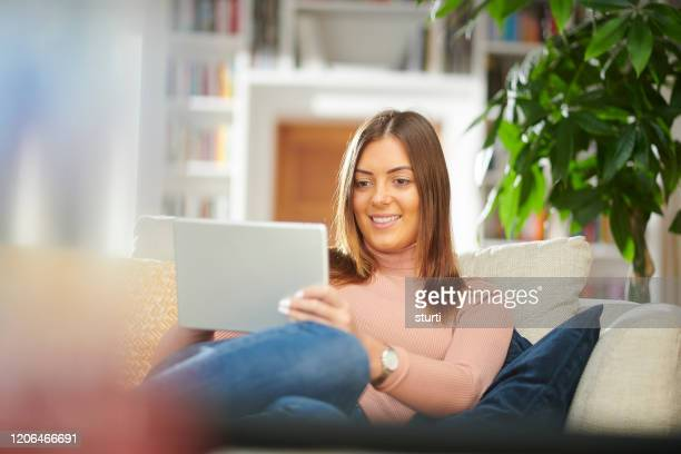 young woman online shopper - neckline stock pictures, royalty-free photos & images