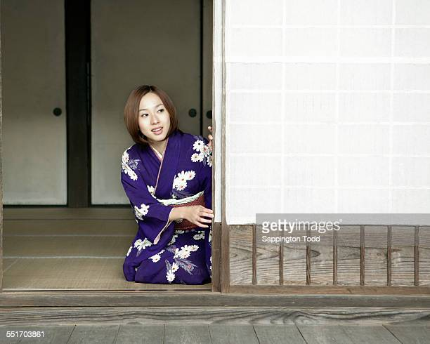 Young Woman Opening The Sliding Door