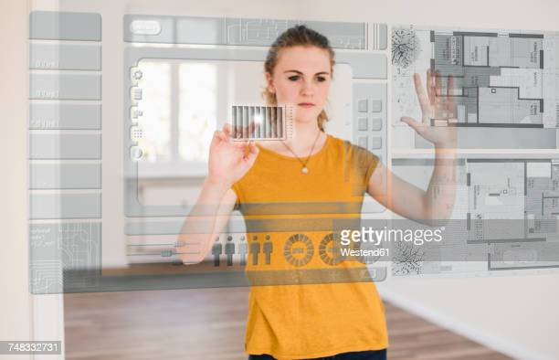 Young woman organizing virtual house model