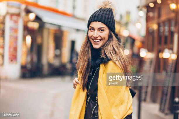 young woman out for shopping - yellow hat stock pictures, royalty-free photos & images