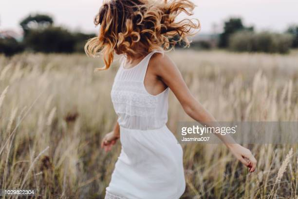young woman outdoor enjoying the sunset - nature stock pictures, royalty-free photos & images