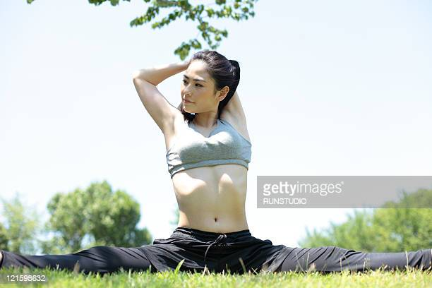 young woman outdoor exercise,stretch - ブラトップ ストックフォトと画像