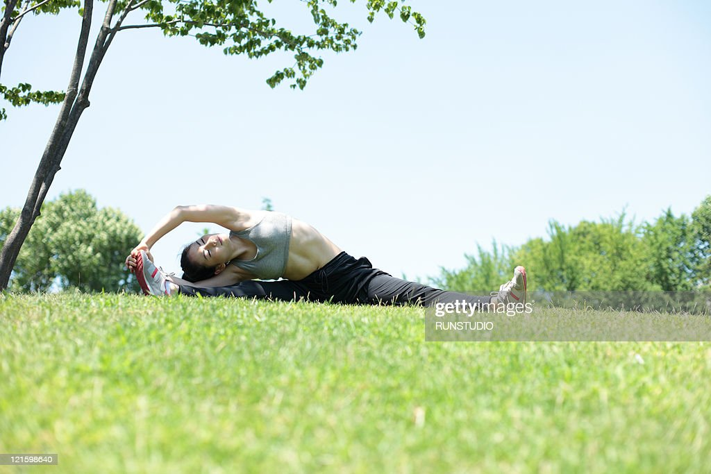 young woman outdoor exercise,stretch : Stock Photo