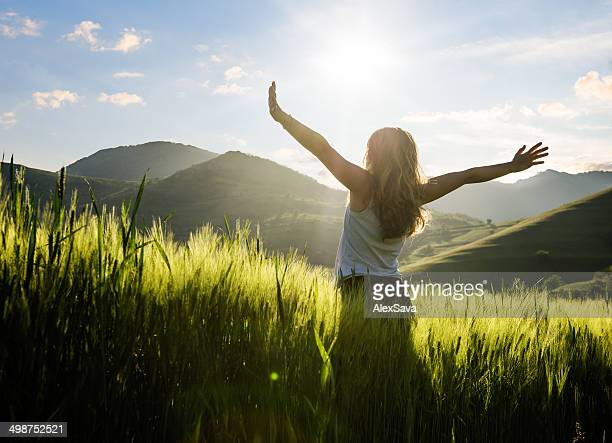 Young woman outdoor in the field enjoying the sun