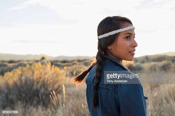Young woman outdoors at sunset