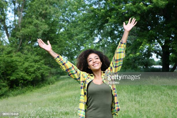 young woman outdoors in nature - place of worship stock pictures, royalty-free photos & images