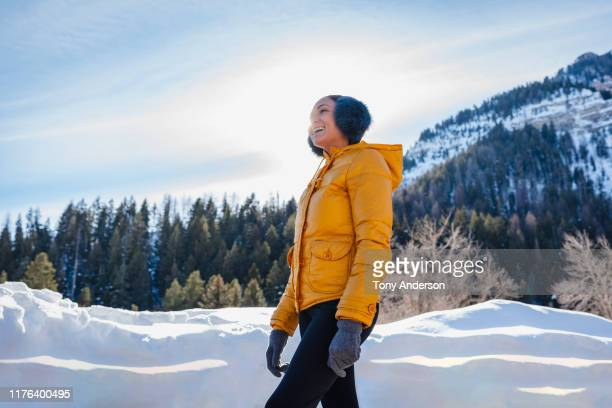 young woman outdoors in snowy mountains - 冠雪 ストックフォトと画像