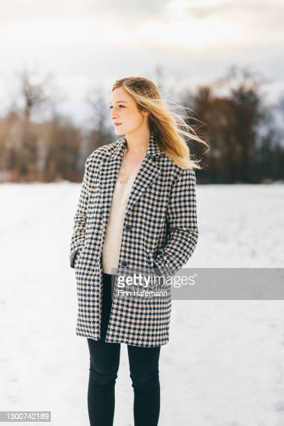 young woman outdoors in winter landscape - coat stock pictures, royalty-free photos & images
