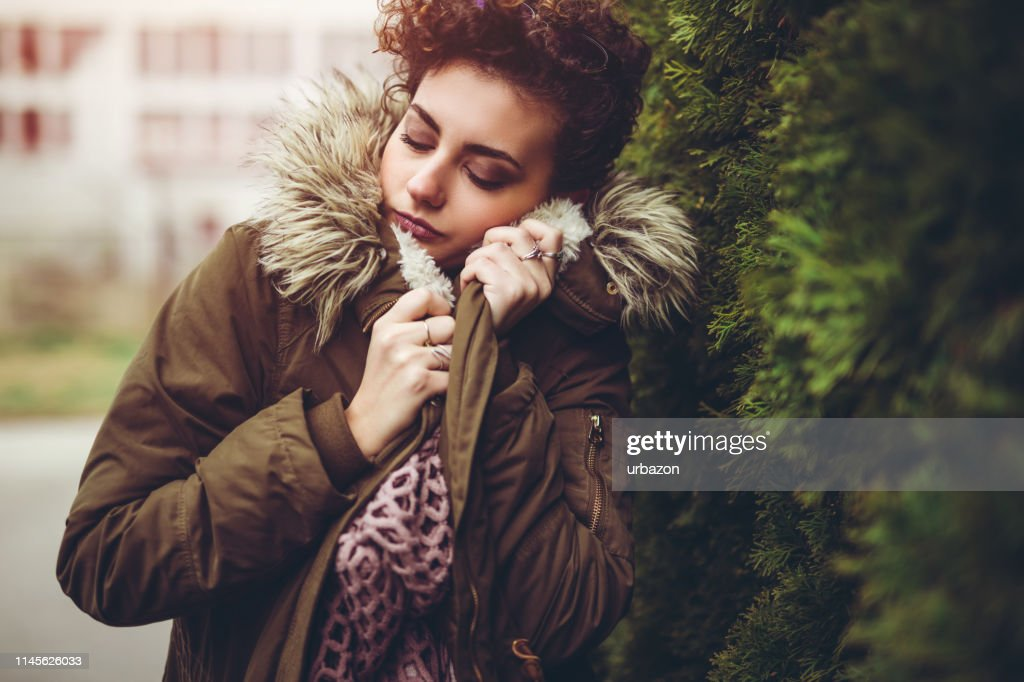 Young woman outdoors in winter : Stock Photo