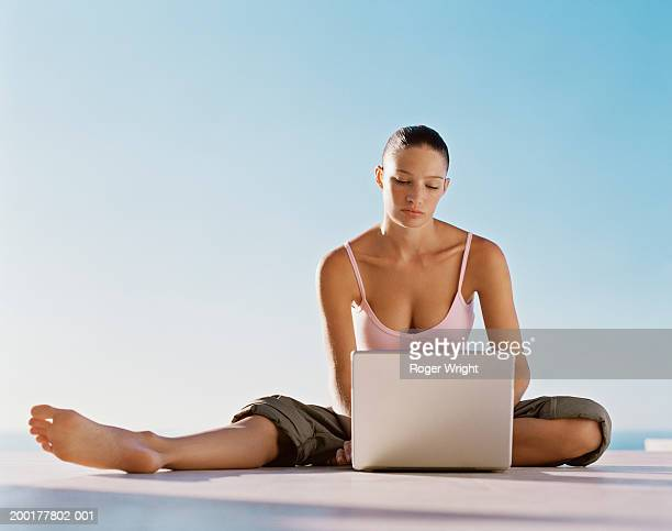 Young woman outdoors using laptop computer