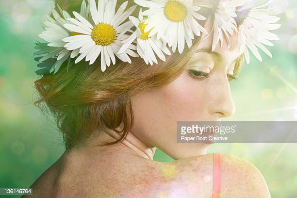 young woman outdoors with a daisy head garland