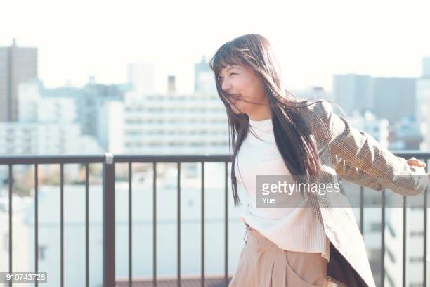 young woman outside on sunny winter day - mulher japonesa imagens e fotografias de stock