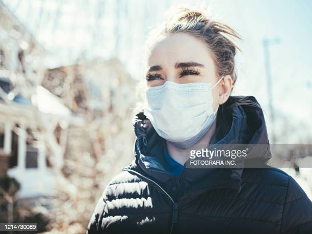covid-19, young woman outside - ontario canada stock pictures, royalty-free photos & images