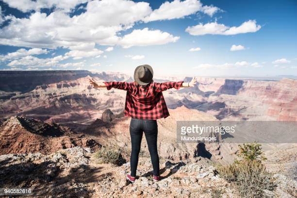 Young Woman Overlooking The Grand Canyon