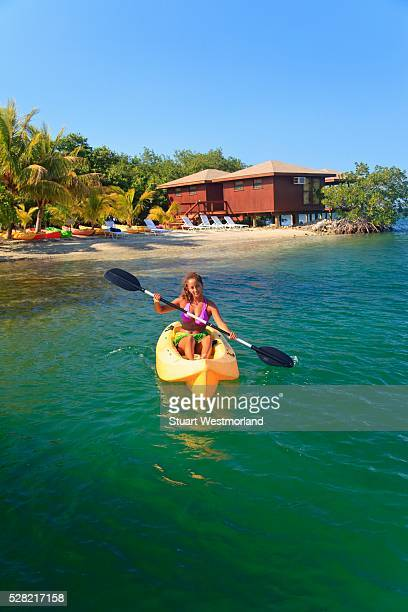 A Young Woman Paddling A Kayak At Anthony's Key Resort