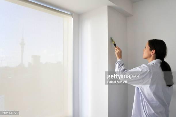 young woman painting city apartment - rafael ben ari imagens e fotografias de stock